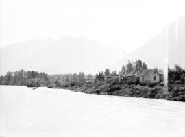 [First Nations settlement beside a river]
