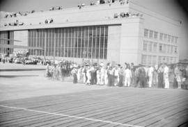 "[Workers gathered outside Boeing plant at Sea Island for launch of first PBY Catalina ""Athlo..."