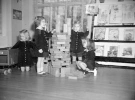 [Little girls playing with blocks and a wooden truck at the Preparatory School for Little Children]
