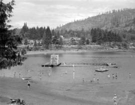 [View of beach at Bowen Island showing swimming area and slide]
