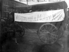 Vancouver [Salvation Army] band serenading [from horse drawn carriage with Christmas banner]