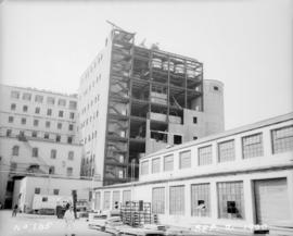 Construction of new pan house: view of exterior panels started