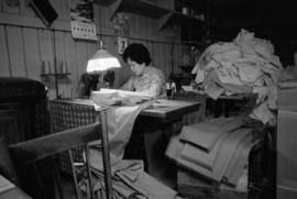 Seamstress working at Wing Hing Dry Goods Ltd.