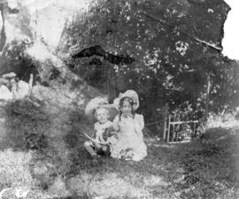 [Mrs. Bell-Irving and her children Robin and Dorothy in the back garden of their home at 1121 Sea...