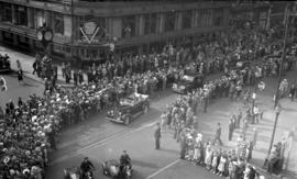 [Crowd watching parade of cars along Georgia Street]