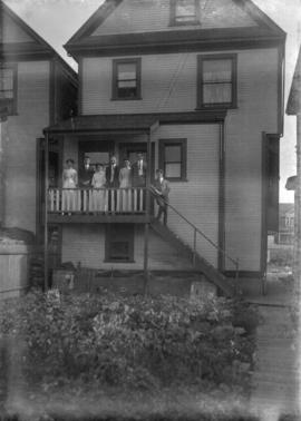 [Unidentified group on the back porch of a house]