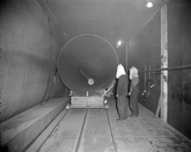 [Men painting a boiler at Vancouver Iron Works Ltd.]