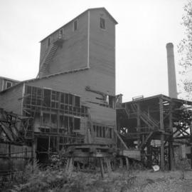 [Buildings and large chimney at a mine]