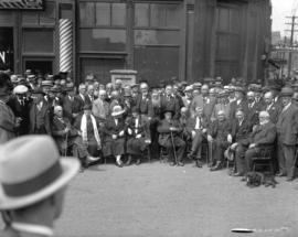[Men and women gathered for the unveiling of the Maple Tree Monument at Carrall and Water Streets]
