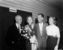P.N.E. President J.S.C. Moffitt and Miss P.N.E. Glenda Sjoberg posing with unidentified man and w...