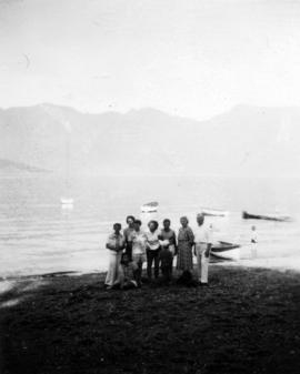 [An unidentified group on the beach in front of W.J. Twiss' summer cottage]
