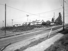 Slocan Street, west side, 8th Ave. to Broadway - view northwest