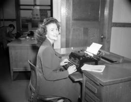 [B.C. Telephone employee at a typewriter]