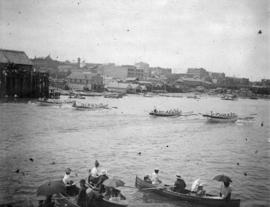 [View of longboat racing in the inner harbour]