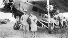 "[Mr. and Mrs. Gerald Ashthorpe in front of a B.C. Airways Ltd. ""Ford Transport"" airplane]"