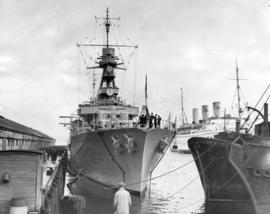 "[Bow and upper deck of French warship ""Jeanne D'Arc"" docked at C.P.R. Pier A]"