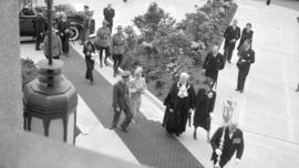 [H.R.H. King George and H.R.H. Queen Elizabeth are escorted into city hall by Mayor and Mrs. Lyle...