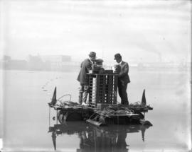 [Three men on float in False Creek conducting an electrolysis survey]