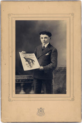 Portrait of a young Sherwood Lett holding a copy of The Saturday Evening Post newspaper