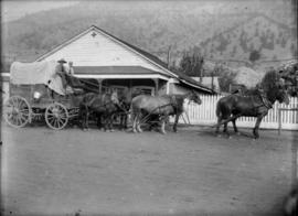 Cummin's store with horse drawn covered wagon