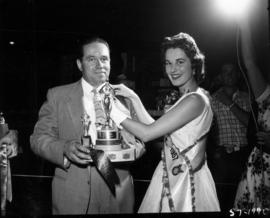Carol Lucas, Miss P.N.E., presenting trophy at 1957 P.N.E. Poultry competition
