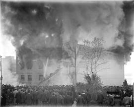 [Fire at Cottrell's warehouse, firemen and crowd watching]
