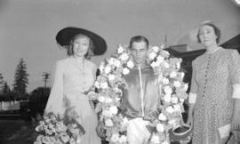 [Miss. Anna Neagle with winning jockey at Hastings Park race track]