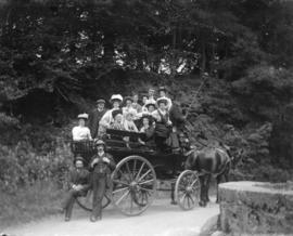 [Unidentified group in horse-drawn carriage]
