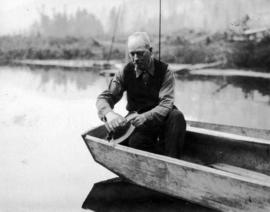 [L.D. Taylor in a boat fishing]