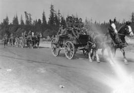 [Army Service Corps in horse drawn wagons at entrance to Stanley Park]