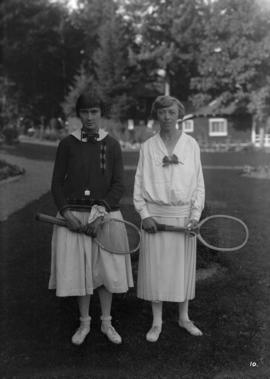 Two women holding tennis racquets