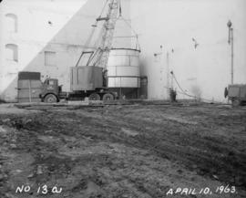 Liquid sugar station construction; Placing upper section on first tank