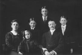 [Mr. and Mrs. Eburne with four of their children]