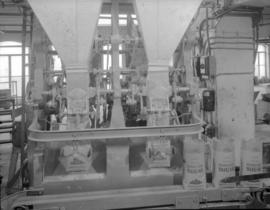 [Machines for filling bags of sugar at the B.C. Sugar Refining Co., Ltd.]