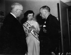 Miss P.N.E., Lynn Adcock, speaking with P.N.E. President J.S.C. Moffitt and director