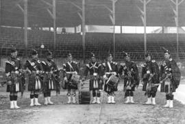 [A pipe and drum band at police sports at Recreation Park on the southeast corner of Smithe Stree...