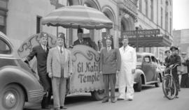 [Float and members of the Shriner El-Kahf Temple of Spokane, Washington outside the Hotel Vancouver]