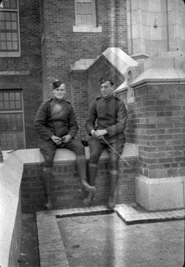 James Crookall and H.M. on steps