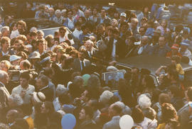 Crowd around Jeanne Sauvé as she exits automobile