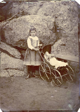 [Portrait of a girl with a doll's buggy]