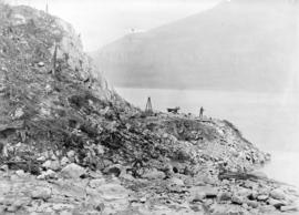 [Man with wheelbarrows and other equipment clearing site for Buntzen Lake Power Plant number one]