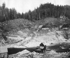 Coquitlam dam showing headworks cut, rock placed in upstream toe wall and shaft No. 1 on Westmins...