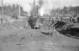 [Steam-powered shovel excavating near causeway and Lost Lagoon]