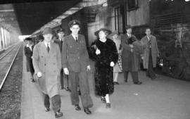 [Airforce officer walking along C.N.R. platform with his parents, taken for Sel Belden of H.B. Co.]