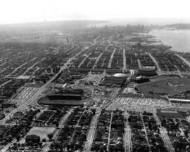 Aerial photograph of P.N.E. grounds and surrounding area looking west, including Downtown Vancouv...