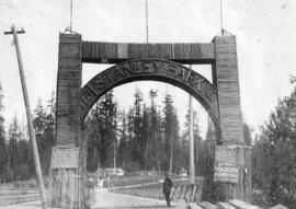 [Reverend G.H. Raley at the entrance to Stanley Park]