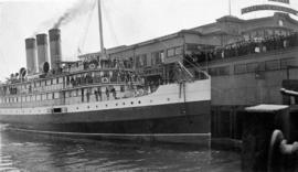 "C.P.R.'s passenger vessel ""Princess Victoria"" at Pier D with crowds on dock"