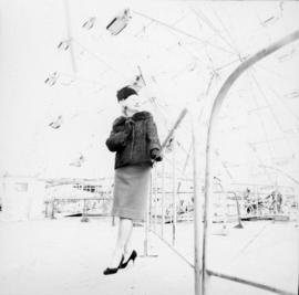Woman next to Ferris wheel in P.N.E. Playland