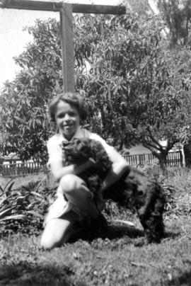 Mary Louise Taylor [outside with dog]