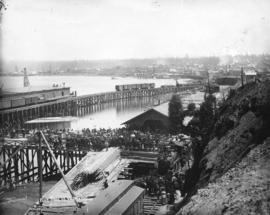 [Crowds at C.P.R. wharf viewing the arrival of the] first train in Vancouver